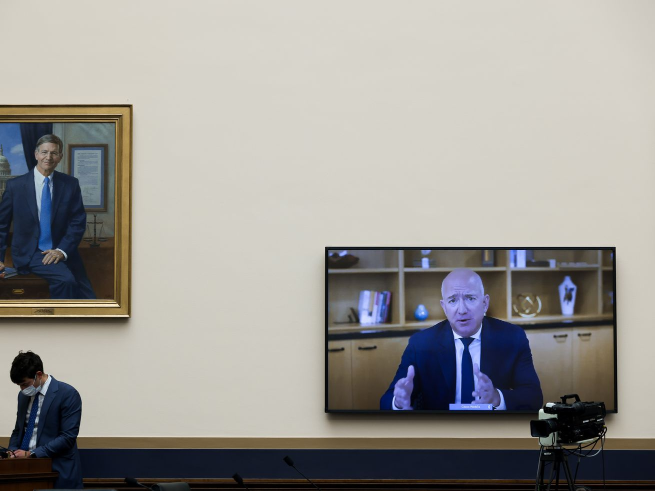 Amazon CEO Jeff Bezos appears on a screen inside the US House of Representatives.