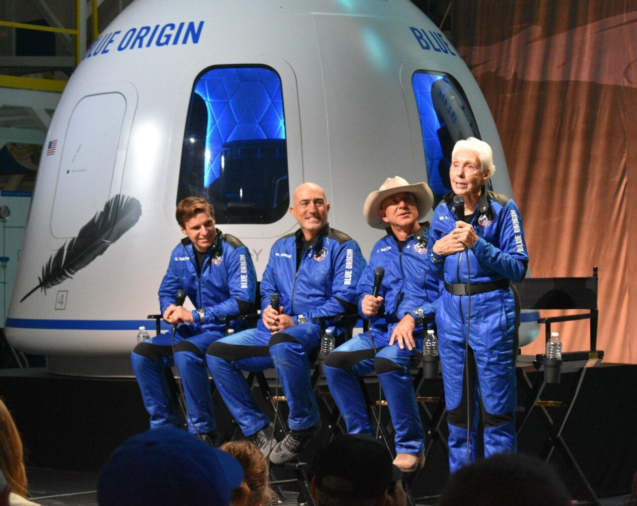 Four spacefliers at post-landing briefing